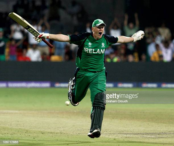 Kevin O'Brien of Ireland celebrates scoring a century batting against England in the Group B 2011 ICC World Cup match between England and Ireland at...