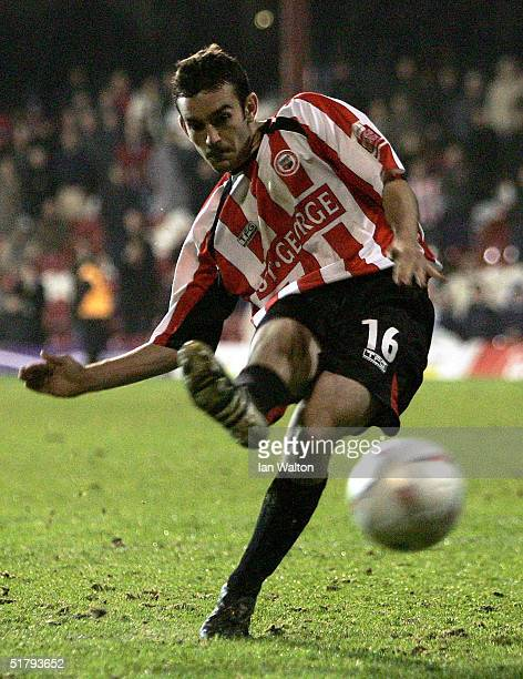 Kevin O'Connor of Brentford scores in the penalty shoot out during the FA Cup first round replay match between Brentford and Bristol City at Griffin...