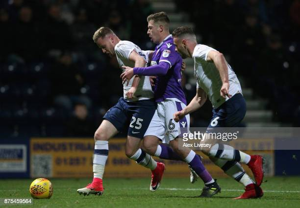 Kevin OConnor of Preston North End holds off a challenge from Josh Vela of Bolton Wanderers during the Sky Bet Championship match between Preston...