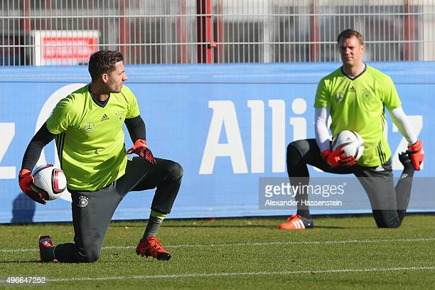Kevin of the German national team and his team mate Manuel Neuer during a training session at Bayern Muenchen's trainings ground Saebener Strasse on...
