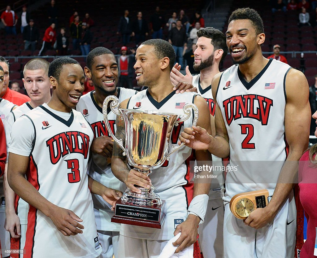 Kevin Olekaibe #3, Roscoe Smith #1, Bryce Dejean-Jones #13, Carlos Lopez-Sosa #11 and Khem Birch #2 of the UNLV Rebels celebrate with the championship trophy after defeating the Mississippi State Bulldogs 82-66 to win the 2013 Continental Tire Las Vegas Classic at the Orleans Arena on December 23, 2013 in Las Vegas, Nevada.