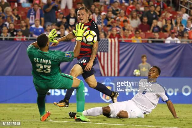 Kevin Olimpa of Martinique blocks the attempt of Jordan Morris of the United States during the 2017 CONCACAF Gold Cup Group B match between the...
