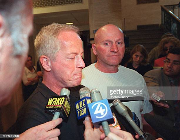 Kevin O'Toole left and Michael O'Toole talk with reporters after the arraignment of former priest Paul R Shanley on child rape charges at Newton...