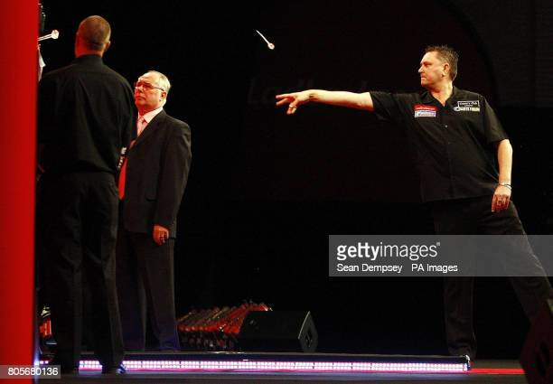 Kevin Painter in action against Menser Suljovic during the Ladbrokescom World Darts Championship at Alexandra Palace London