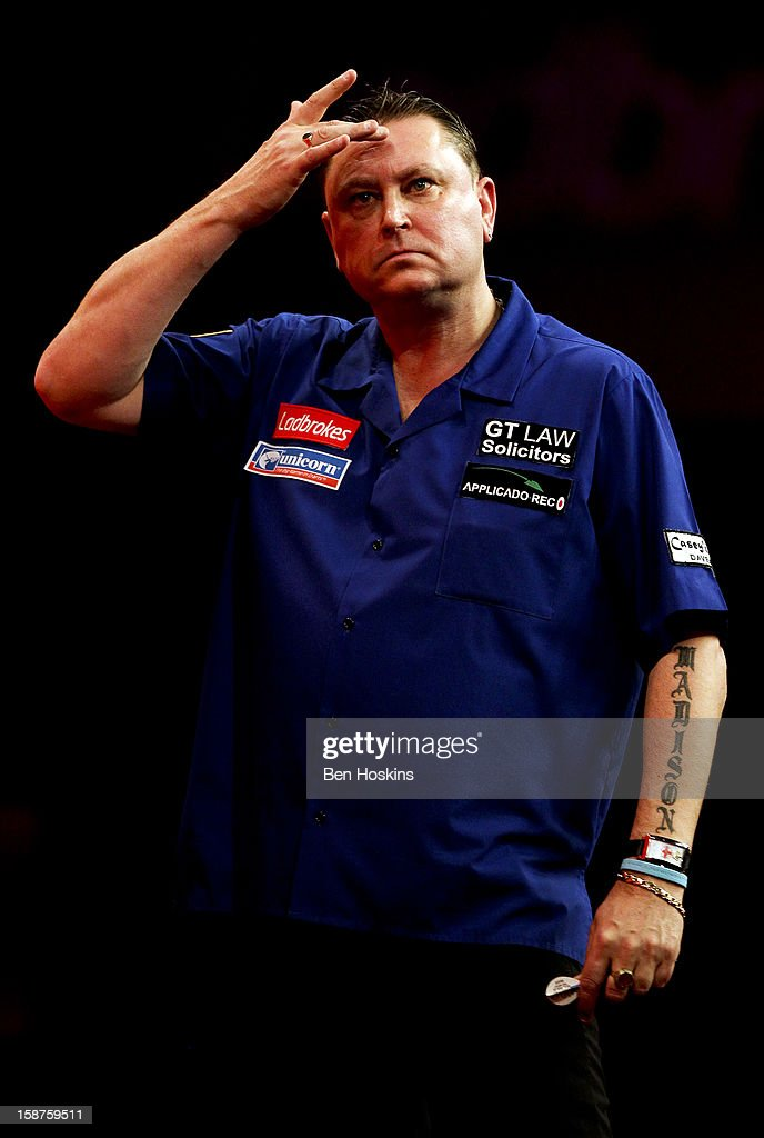 <a gi-track='captionPersonalityLinkClicked' href=/galleries/search?phrase=Kevin+Painter&family=editorial&specificpeople=206900 ng-click='$event.stopPropagation()'>Kevin Painter</a> of England reacts during his third round match against Adrian Lewis on day eleven of the 2013 Ladbrokes.com World Darts Championship at the Alexandra Palace on December 27, 2012 in London, England.