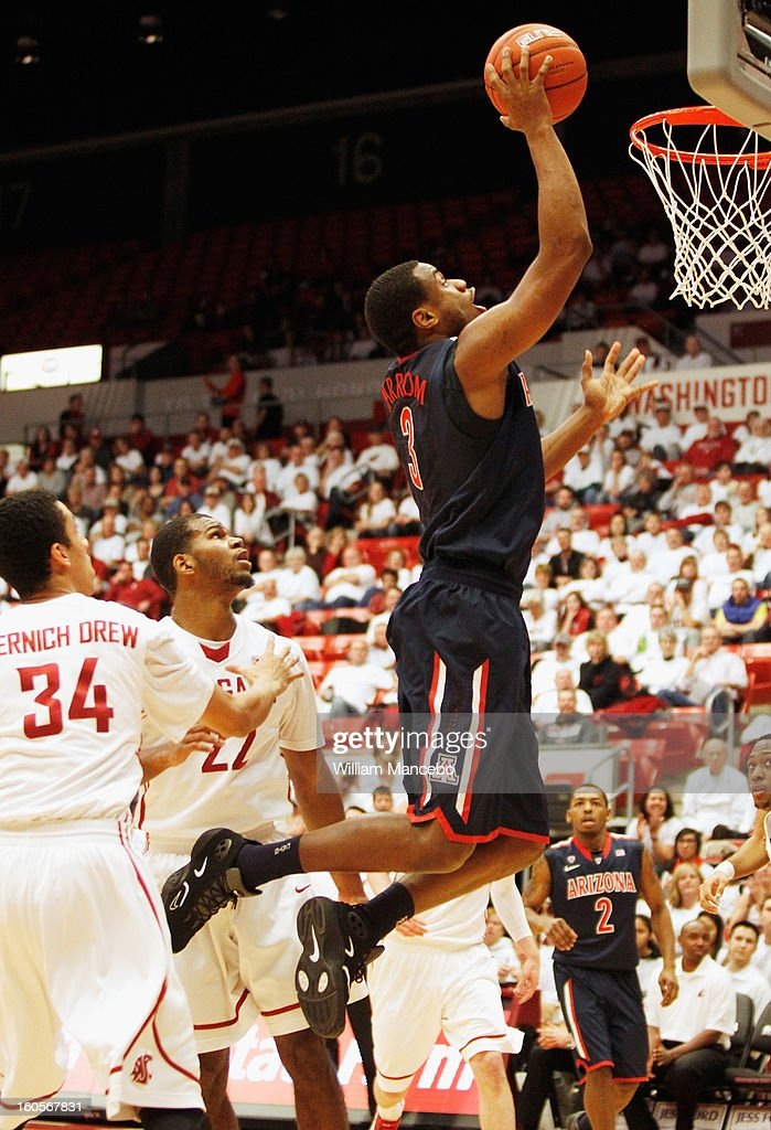 Kevin Parrom #3 of the Arizona Wildcats goes to the hoop during the first half of the game against the Washington State Cougars at Beasley Coliseum on February 2, 2013 in Pullman, Washington.