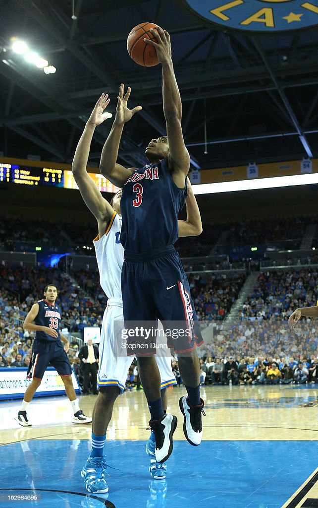 Kevin Parrom #3 of the Arizona Wildcats goes up for a shot against the UCLA Bruins at Pauley Pavilion on March 2, 2013 in Los Angeles, California. UCLA won 74-69.