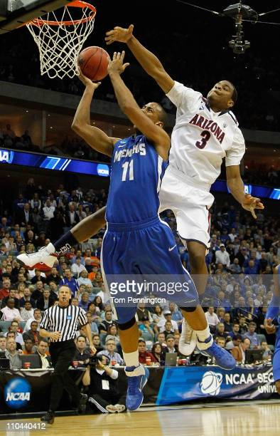 Kevin Parrom of the Arizona Wildcats looks to block a shot by Wesley Witherspoon of the Memphis Tigers during the second round of the 2011 NCAA men's...