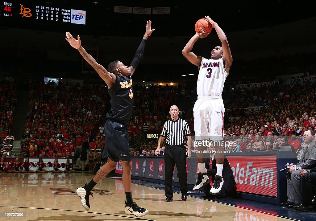 Kevin Parrom #3 of the Arizona Wildcats puts up a three point shot over Kris Gulley #0 of the Long Beach State 49ers during the second half of the college basketball game at McKale Center on November 19, 2012 in Tucson, Arizona. The Wildcats defeated the 49ers 94-72.