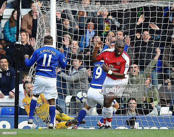 Kevin Phillips of Birmingham City scores the equaliser much to the dismay of Sol Campbell of Arsenal during the Barclays Premier League match between...