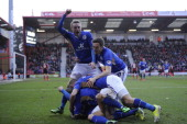 Kevin Phillips of Leicester City is smothered by teammates as he celebrates scoring a goal during the Sky Bet Championship match between Bournemouth...