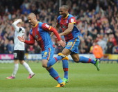 Kevin Phillips of Palace is chased by Danny Gabbidon after he scores their second goal during the npower Championship match between Crystal Palace...