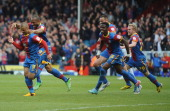 Kevin Phillips of Palace is chased by his team mates after he scores their second goal during the npower Championship match between Crystal Palace...