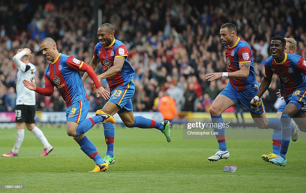 Kevin Phillips of Palace is chased by his team mates after he scores their second goal during the npower Championship match between Crystal Palace and Peterborough United at Selhurst Park on May 04, 2013 in London, England.