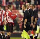 Kevin Phillips of Sunderland argues with referee M Dean over the penalty decision during the FA Cup 5th round match between Sunderland and Watford at...