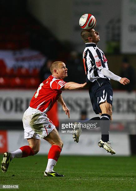 Kevin Phillips of West Brom heads the ball as Ben Thatcher of Charlton closes in during the Coca Cola Championship match between Charlton Athletic...