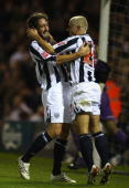 Kevin Phillips of West Bromwich Albion celebrates his goal with team mate Jonathan Greening during the CocaCola Championship match between West...