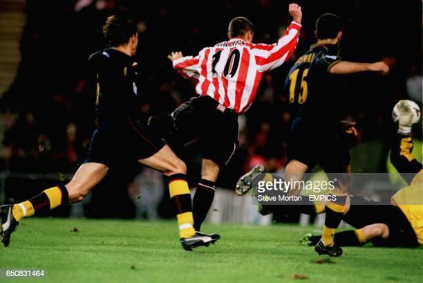 Kevin Phillips slots the ball past southampton keeper Paul Jones and defander Francis Benali sunderland's opening goal