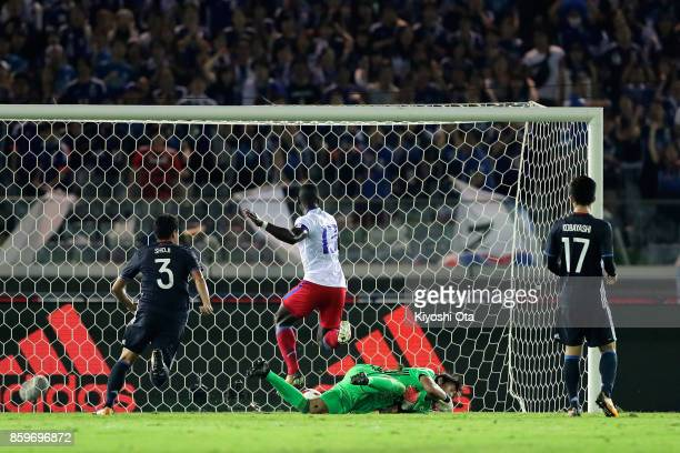 Kevin Pierre Lafrance of Haiti scores his side's first goal past Masaaki Higashiguchi of Japan during the international friendly match between Japan...