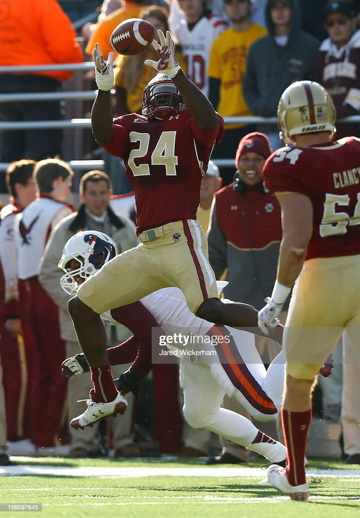 Kevin Pierre-Louis #24 of the Boston College Eagles attempts to intercept a pass against the Virginia Tech Hokies during the game on November 17, 2012 at Alumni Stadium in Chestnut Hill, Massachusetts.