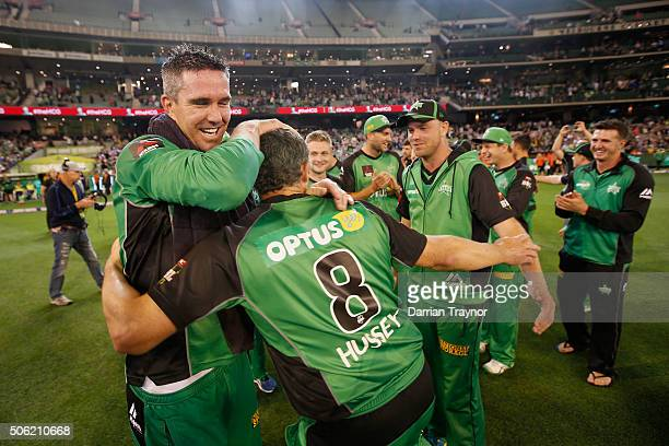 Kevin Pietersen and David Hussey of the Melbourne Stars embrace after winning the Big Bash League Semi Final match against the Perth Scorchers at...