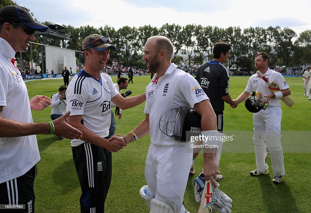 Kevin Pietersen and Jonathan Trott of England shake hands with Matt Prior after drawing the First Test match between New Zealand and England at University Oval on March 10, 2013 in Dunedin, New Zealand.