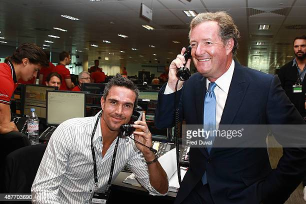 Kevin Pietersen and Piers Morgan attend the annual BGC Global Chariry Day at BGC Partners on September 11 2015 in London England