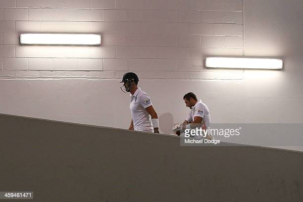 Kevin Pietersen and Tim Bresnan walk out to the ground during day two of the Fourth Ashes Test Match between Australia and England at Melbourne...