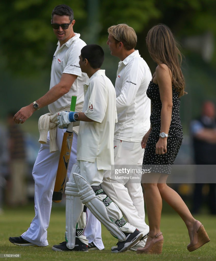 Kevin Pietersen, Elizabeth Hurley and Shane Warne pictured with Iqbal Singh during the Shane Warne's Australia vs Michael Vaughan's England T20 match at Circenster Cricket Club on June 9, 2013 in Cirencester, England.