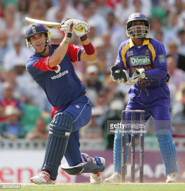 Kevin Pietersen hits a four during his innings of 73 runs watched by Sri Lanka's Kumar Sangakkara during the 2nd NatWest Series One Day International...