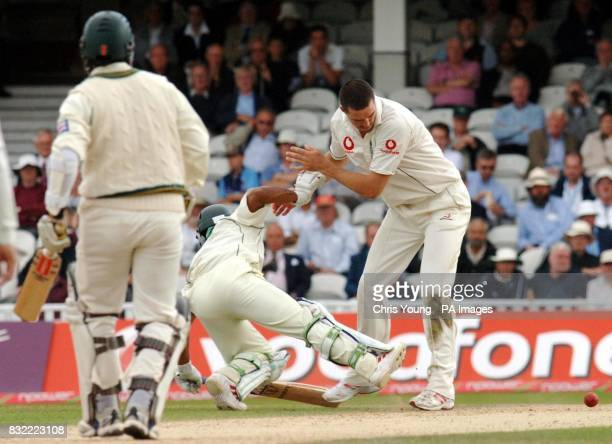 Kevin Pietersen knocks down Mohammad Hafeez during the second day of the fourth NPower test between England and Pakistan at the Brit Oval Kennington...