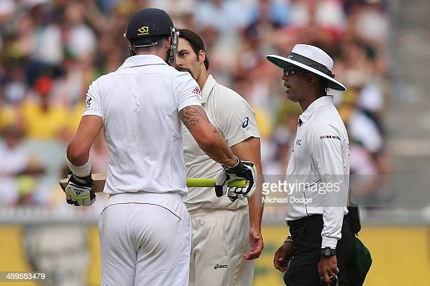 Kevin Pietersen of England and Mitchell Johnson of Australia have a confrontation on the pitch during day three of the Fourth Ashes Test Match...