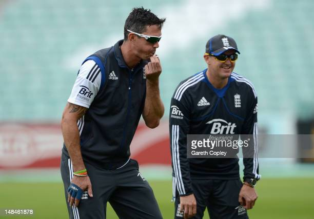 Kevin Pietersen of England blows a whistle alongside coach Andy Flower during a nets session at The Kia Oval on July 17 2012 in London England