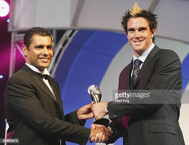 Kevin Pietersen of England collects his Emerging Player of the Year trophy from former Pakistan test player Waqar Younis during the ICC Awards...
