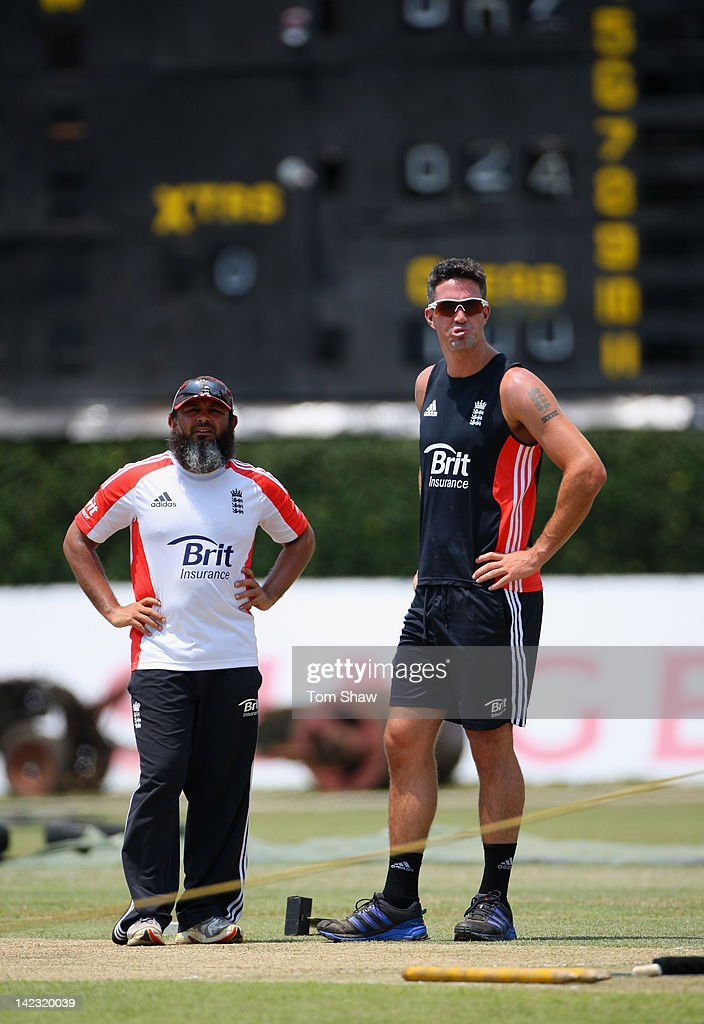 Kevin Pietersen of England has a chat with bowlng coach Mushtaq Ahmed during the England nets session at the P Sara Stadium on April 2 2012 in...