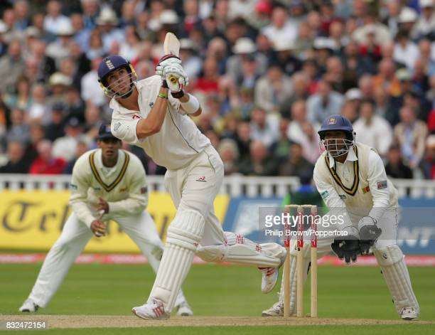Kevin Pietersen of England hits a six during his innings of 142 runs watched by Sri Lanka wicketkeeper Kumar Sangakkara in the 2nd Test match between...
