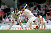 Kevin Pietersen of England hits out as Matthew Hayden and Adam Gilchrist of Australia watch on during day five of the fifth npower Ashes Test match...