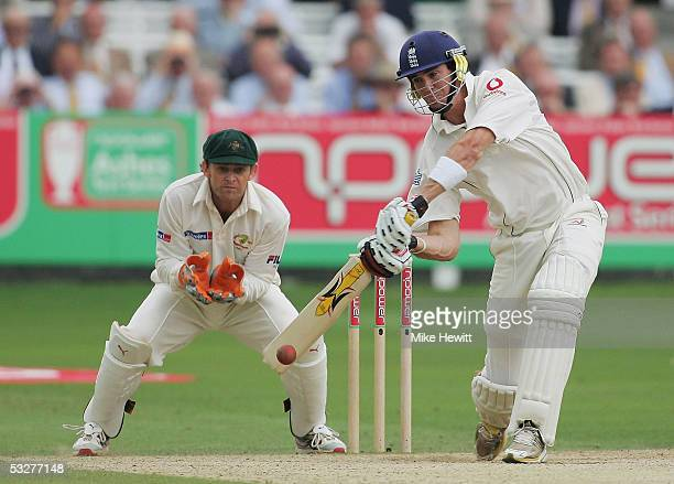Kevin Pietersen of England hits out off the bowling of Shane Warne of Australia as Adam Gilchrist looks on during day three of the first npower Ashes...