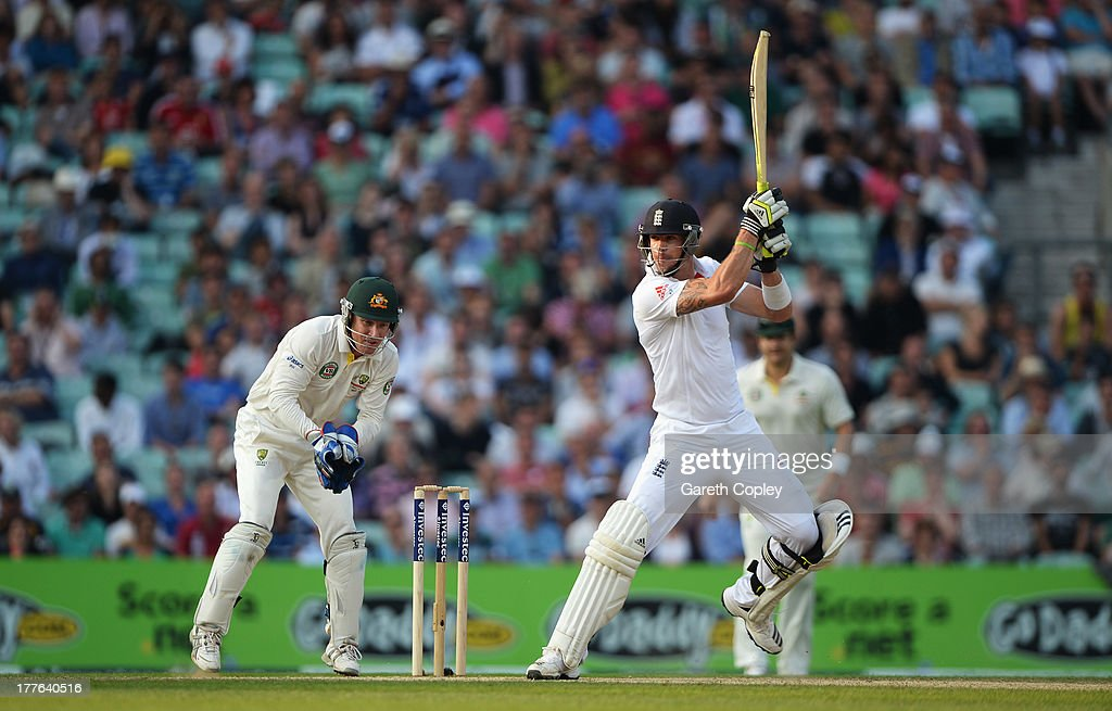 Kevin Pietersen of England hits out watched by wicketkeeper Brad Haddin of Australia during day five of the 5th Investec Ashes Test match between England and Australia at the Kia Oval on August 25, 2013 in London, England.