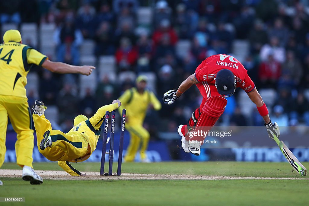 <a gi-track='captionPersonalityLinkClicked' href=/galleries/search?phrase=Kevin+Pietersen+-+Cricket+Player&family=editorial&specificpeople=202001 ng-click='$event.stopPropagation()'>Kevin Pietersen</a> of England is run out by Phil Hughes of England of Australia during the 5th NatWest Series ODI between England and Australia at the Ageas Bowl on September 16, 2013 in Southampton, England.