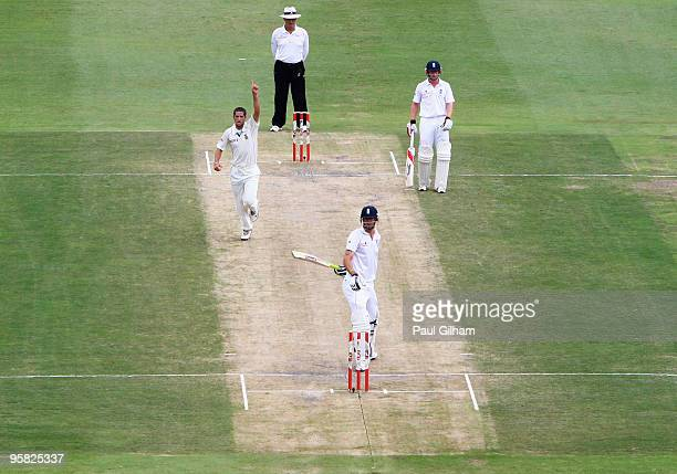 Kevin Pietersen of England looks dejected as Wayne Parnell of South Africa celebrates taking his wicket for 12 runs when he was caught behind by Mark...