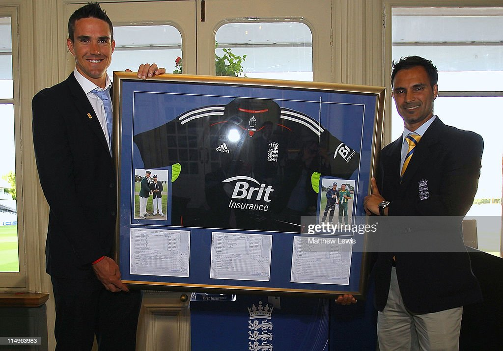Kevin Pietersen (L) of England presents Umesh Valjee of England with a framed England shirt during the ECB Cricketer of the Year Dinner at Lord's Cricket Ground on May 31, 2011 in London, England.