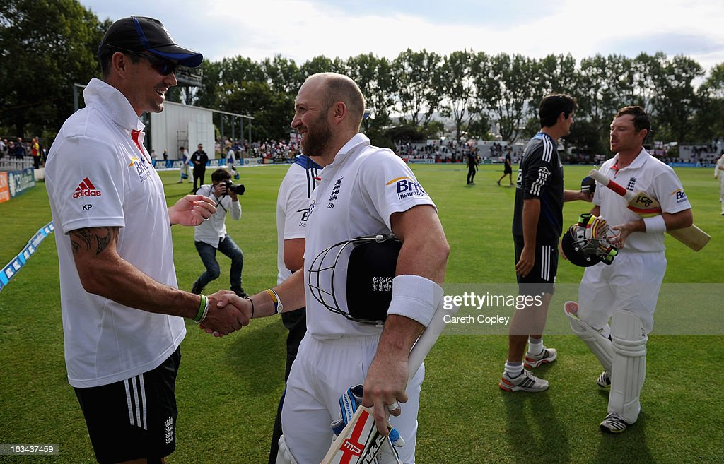 Kevin Pietersen of England shakes hands with Matt Prior after drawing the First Test match between New Zealand and England at University Oval on March 10, 2013 in Dunedin, New Zealand.