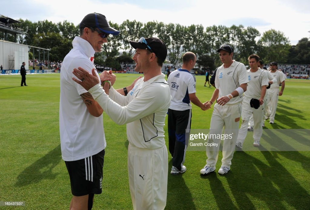 Kevin Pietersen of England shakes hands with New Zealand captain Brendon McCullum after drawing the First Test match between New Zealand and England at University Oval on March 10, 2013 in Dunedin, New Zealand.
