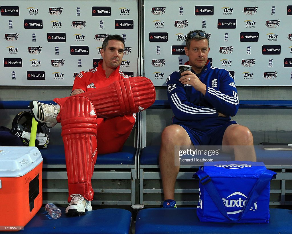 <a gi-track='captionPersonalityLinkClicked' href=/galleries/search?phrase=Kevin+Pietersen+-+Cricket+Player&family=editorial&specificpeople=202001 ng-click='$event.stopPropagation()'>Kevin Pietersen</a> of England sits in his pads with coach <a gi-track='captionPersonalityLinkClicked' href=/galleries/search?phrase=Ashley+Giles&family=editorial&specificpeople=184493 ng-click='$event.stopPropagation()'>Ashley Giles</a> as the game is abandoned during the 2nd Natwest International T20 match between England and New Zealand at The Kia Oval on June 27, 2013 in London, England.