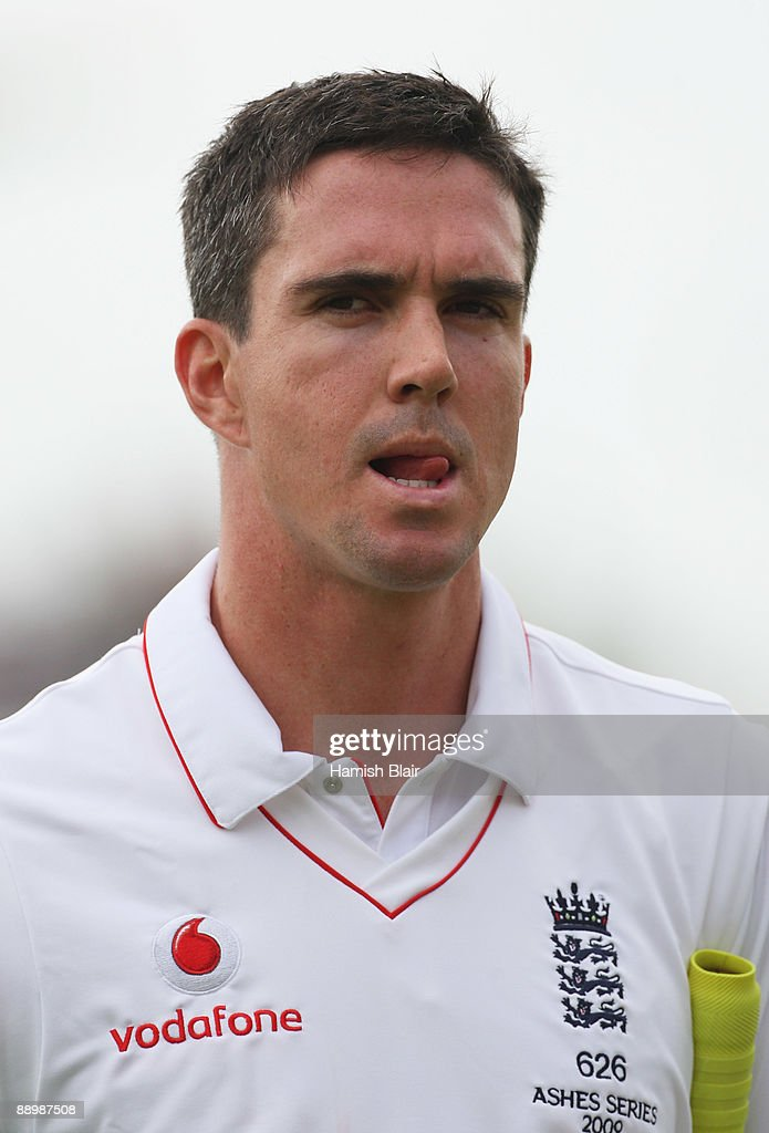 <a gi-track='captionPersonalityLinkClicked' href=/galleries/search?phrase=Kevin+Pietersen+-+Cricket+Player&family=editorial&specificpeople=202001 ng-click='$event.stopPropagation()'>Kevin Pietersen</a> of England walks back after being dismissed by Ben Hilfenhaus of Australia during day five of the npower 1st Ashes Test Match between England and Australia at the SWALEC Stadium on July 12, 2009 in Cardiff, Wales.