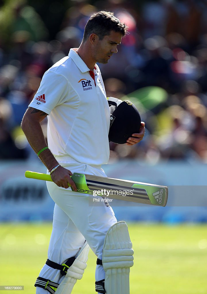 Kevin Pietersen of England walks off the field after being dismissed LBW by Neil Wagner of New Zealand during day two of the First Test match between New Zealand and England at University Oval on March 7, 2013 in Dunedin, New Zealand.