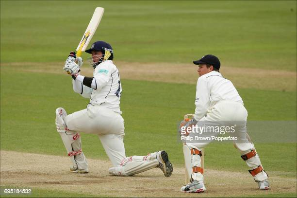 Kevin Pietersen of Hampshire hits a six off Min Patel of Kent on his way to a century during the County Championship Division One match between Kent...