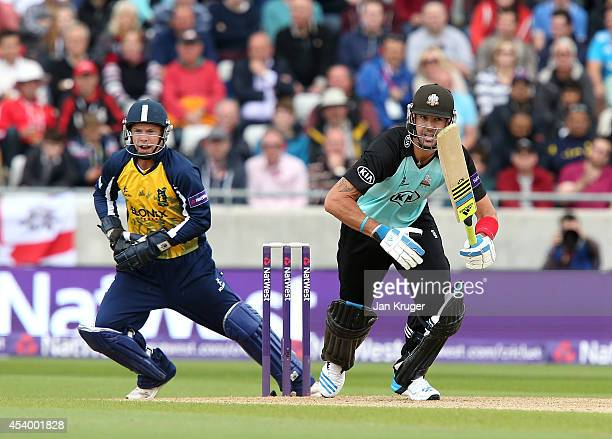 Kevin Pietersen of Surrey bats with Tim Ambrose of Birmingham bears looking on during the Natwest T20 Blast Semi Final match between Birmingham Bears...