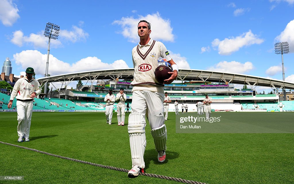 Kevin Pietersen of Surrey leaves the field at the end of the Surrey innings on 355 not out during day three of the LV County Championship match between Surrey and Leicestershire at The Kia Oval on May 12, 2015 in London, England.